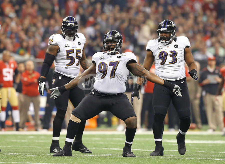Feb 3, 2013; New Orleans, LA, USA; Baltimore Ravens defensive end Arthur Jones (97) celebrates a tackle as teammates Terrell Suggs (55) and DeAngelo Tyson (93) look on against the San Francisco 49ers in Super Bowl XLVII at the Mercedes-Benz Superdome. Mandatory Credit: Mark J. Rebilas-