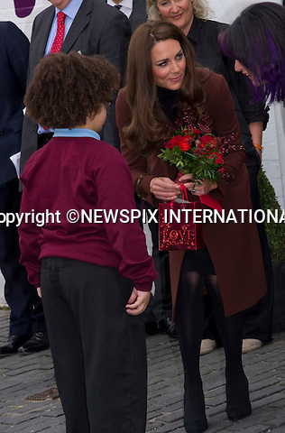 "CATHERINE, DUCHESS OF CAMBRIDGE SOLO VALENTINE'S DAY.Kate spent her first Valentine's Day of married life on her own, with Prince William away in the Falkland Islands London..Instead she visited a couple of her charities in Liverpool - The Brink and Alder Hey Children's Hospital..On her visit to The Brink, Kate received red roses, a Valentine card and a gift ..MANDATORY PHOTO CREDIT:©FRANCIS DIAS - NEWSPIX INTERNATIONAL..Mandatory credit photo:NEWSPIX INTERNATIONAL(Failure to credit will incur a surcharge of 100% of reproduction fees)..**ALL FEES PAYABLE TO: ""NEWSPIX  INTERNATIONAL""**..Newspix International, 31 Chinnery Hill, Bishop's Stortford, ENGLAND CM23 3PS.Tel:+441279 324672.Fax: +441279656877.Mobile:  07775681153.e-mail: info@newspixinternational.co.uk"