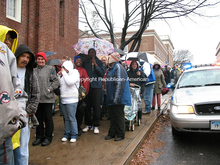 WATERBURY, CT - 25 November 2008 - Hundreds of people lined up in the rain on Tuesday to receive free turkeys and trimmings at the Waterbury Armory on Field Street. The turkey giveaway was coordinated by the United Way of Greater Waterbury for 1,276 clients of Greater Waterbury Interfaith Ministries, Waterbury Baptist Ministries, Hispanic Coalition and First Assembly of God Church. Those five agencies as well as St. Vincent DePaul Society and Church of God had 1,728 requests for assistance, about a 20 percent increase from last year.