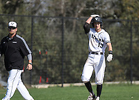 Vandegrift senior Luke Brigham (13) and coach Allen McGee at third base.