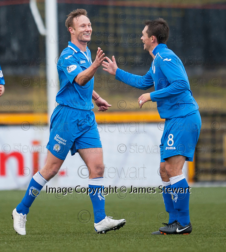 Queen of the South's Iain Russell (left) celebrates with Derek Young (8) after he scores their second goal.