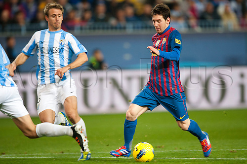 22.01.2012 Malaga, Spain. The La Liga football match between FC Malaga and FC Barcelona played in the La Rosaleda Stadium. Image shows, Ingnacio Monreal (Malaga CF) Lionel Messi from Argentina (FC Barcelona)..