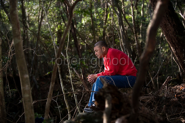 A man, 46, sits in contemplation at the site where exactly 2 years earlier on November 18, 2007 he tried to commit suicide in Aokigahara Jukai, better known as the Mt. Fuji suicide forest, in Yamanashi Prefecture west of Tokyo, Japan on 18 November 2009. .