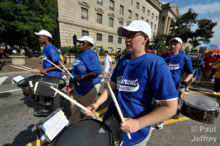 Members of Different Drummers were among participants in a march through the center of Washington, DC, on July 22, 2012, to demand that the U.S. and other governments keep their promises to fund global relief programs for those living with HIV and AIDS. The rally took place as more than 23,000 delegates gathered in the US capital city for the XIX International AIDS Conference. Different Drummers is a musical group that serves the GLBT Community of Washington, DC.