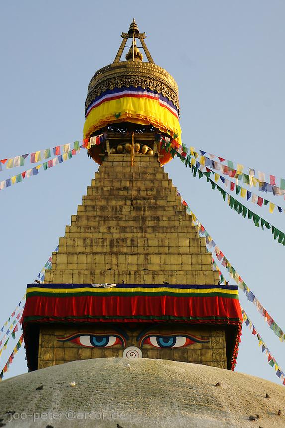 close-up -  top of Boudha stupa in Kathmandu, Nepal. - Boudhanath near Kathmandu is one of the most holy places of buddhist worship and pilgrimage. The ancient Stupa is one of the largest in the world.