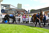 Jockeys wait to enter the Parade Ring during Horse Racing at Salisbury Racecourse on 15th August 2019