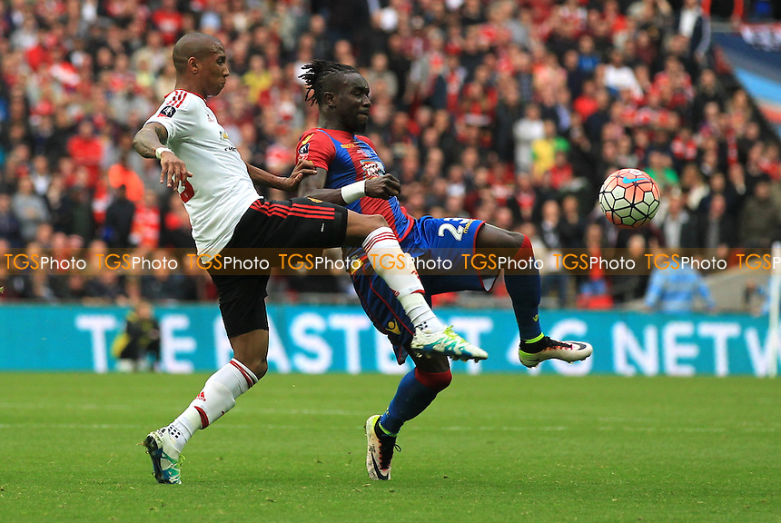 Pape Souare of Crystal Palace and Ashley Young of Manchester United tangle for the ball during Crystal Palace vs Manchester United, Emirates FA Cup Final Football at Wembley Stadium on 21st May 2016