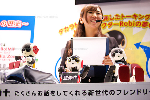 "An exhibitor speaks about the robot ""Robi"" which can speak 1000 Japanese phrases to respond to human voice at the Japan Robot Week 2014 on October 16, 2014 in Tokyo, Japan. Companies at the ""Japan Robot Week 2014"" exhibited their latest high-tech nursing and life supporting robots. The 2014 edition of the show ran from October 15 to 19 at Tokyo Big Sight. (Photo by Rodrigo Reyes Marin/AFLO)"