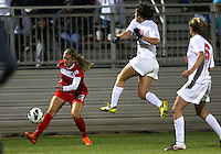 BOYDS, MARYLAND - April 06, 2013:  Stephanie Ochs (22) of The Washington Spirit sends a cross past Danielle Colaprico (24) of the University of Virginia women's soccer team in a NWSL (National Women's Soccer League) pre season exhibition game at Maryland Soccerplex in Boyds, Maryland on April 06. Virginia won 6-3.