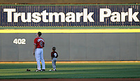 12 April 2008: Carl Loadnthal and a young fan of the Mississippi Braves, Class AA affiliate of the Atlanta Braves, prior to a game against the Mobile BayBears at Trustmark Park in Pearl, Miss. Photo by:  Tom Priddy/Four Seam Images