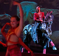 Grégory Molina, right, rides in behind a troupe of dancers and acrobats to begin the Cavalia media preview show. Cavalia opens July 18, 2012 and will play through August 12, 2012 in San Jose.