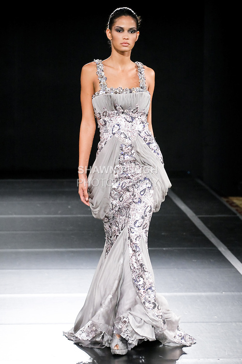 Model walks the runway in an outfit by Jack Guisso for the Jack Guisso Spring 2011 runway show, during Couture Fashion Week, September 12, 2010.