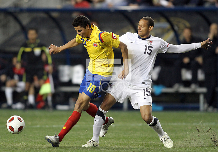 Jermaine Jones #15 of the USA MNT checks Giovani Moreno #10 of Colombia during an international friendly match at PPL Park, on October 12 2010 in Chester, PA. The game ended in a 0-0 tie.