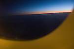 View from EasyJet window at dusk, flying south from Edinburgh. Photo copyright Graham Harrison.