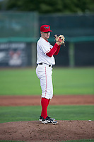 Orem Owlz relief pitcher Christian Aragon (19) gets ready to deliver a pitch during a Pioneer League game against the Ogden Raptors at Home of the OWLZ on August 24, 2018 in Orem, Utah. The Ogden Raptors defeated the Orem Owlz by a score of 13-5. (Zachary Lucy/Four Seam Images)