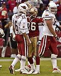 Arizona Cardinals quarterback Jake Plummer (16) and San Francisco 49ers defensive back Jason Webster (36) after interception on Sunday, October 27, 2002, in San Francisco, California. The 49ers defeated the Cardinals 38-28.