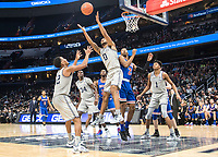 WASHINGTON, DC - DECEMBER 28: Jahvon Blair #0 of Georgetown beats Stacy Beckton JR. #2 of American to a rebound. during a game between American University and Georgetown University at Capital One Arena on December 28, 2019 in Washington, DC.