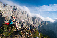 Vrsic pass, Julian Alps, Slovenia, July 2011. We climb from the Vršič pass along the marked path towards north to the Vratca pass, then descend into the hollow from which we ascend Sleme and Slemenova špica. A panoramic mountain walk to beautiful lakes with the view of magnificent Jalovec. Slovenia boast a very spectacular carstic landscape with high limestone rock formations oozing with waterfalls, and fast flowing cristal clear waters that run through the Soca from the Triglav National Park to the Adriatic Sea. Photo by Frits Meyst/Adventure4ever.com