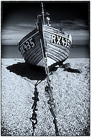 Fishing boat on the shore at Dungeness, Kent