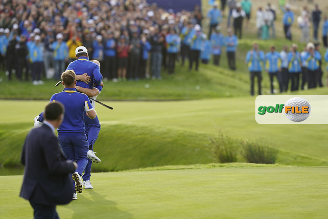 Thorbjorn Olesen (Team Europe) jumps on Alex Noran (Team Europe) celebrating his win on the 18th during the singles matches at the Ryder Cup, Le Golf National, Ile-de-France, France. 30/09/2018.<br /> Picture Fran Caffrey / Golffile.ie<br /> <br /> All photo usage must carry mandatory copyright credit (© Golffile | Fran Caffrey)