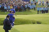 Thorbjorn Olesen (Team Europe) jumps on Alex Noran (Team Europe) celebrating his win on the 18th during the singles matches at the Ryder Cup, Le Golf National, Ile-de-France, France. 30/09/2018.<br /> Picture Fran Caffrey / Golffile.ie<br /> <br /> All photo usage must carry mandatory copyright credit (&copy; Golffile | Fran Caffrey)