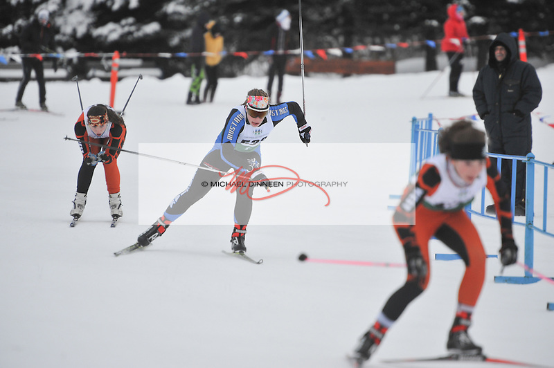 Chugiak's Heidi Booher skates inbetween a pair of West skiers in a sprint race at the Service Snowball races at Kincaid Park Saturday, Dec. 3, 2016.  Photo by Michael Dinneen for the Star.