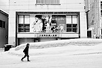 "An elderly man walks past a shuttered building once housing a center for teenage women in Yubari City, on the northernmost island of Hokkaido, Japan. More than 40 percent of Yubari's fast-diminishing population is made up of over-65-year-olds, reportedly the highest proportion of elderly citizens in Japan. Yubari was once a well-respected venue for an international film festival and on the wall of the building is a poster for the film East of Eden""."