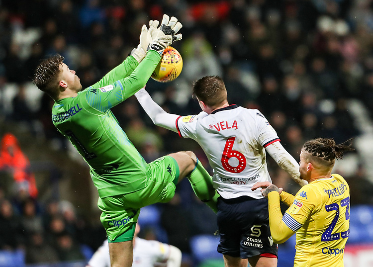Bolton Wanderers' Josh Vela competing with Leeds United's goalkeeper Bailey Peacock-Farrell<br /> <br /> Photographer Andrew Kearns/CameraSport<br /> <br /> The EFL Sky Bet Championship - Bolton Wanderers v Leeds United - Saturday 15th December 2018 - University of Bolton Stadium - Bolton<br /> <br /> World Copyright © 2018 CameraSport. All rights reserved. 43 Linden Ave. Countesthorpe. Leicester. England. LE8 5PG - Tel: +44 (0) 116 277 4147 - admin@camerasport.com - www.camerasport.com