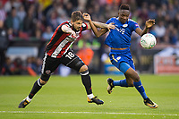 Ahmed Musa of Leicester City battles with Kieron Freeman of Sheffield United during the Carabao Cup match between Sheffield United and Leicester City at Bramall Lane, Sheffield, England on 22 August 2017. Photo by James Williamson / PRiME Media Images.