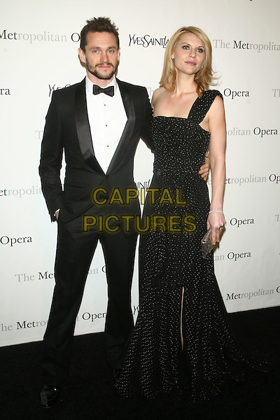 "HUGH DANCY & CLAIRE DANES.Metropolitan Opera Gala Premiere Of Rossini's ""Le Comte Ory"" Sponsored By Yves Saint Laurent held at The Metropolitan Opera House, New York, NY, USA..March 24th, 2011.full length black one shoulder dress beads beaded tuxedo maxi clutch bag beard facial hair married husband wife .CAP/LNC/TOM.©LNC/Capital Pictures."
