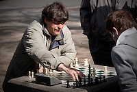 2 man play chess in a park at the corner of Church and Queen street in Toronto April 20, 2010.