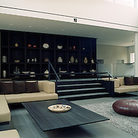 In the living area a low coffee table seems to hover in space creating a feeling of lightness and tranquillity