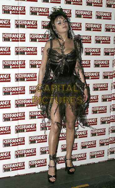 FLAVIER.Kerrang Awards 2004, The Brewery, East London, .August 26th 2004..full length ripped dress.Ref: AH.www.capitalpictures.com.sales@capitalpictures.com.©Capital Pictures.