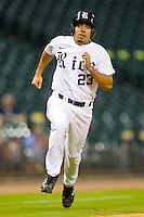 Anthony Rendon #23 of the Rice Owls scores a run against the Kentucky Wildcats at Minute Maid Park on March 4, 2011 in Houston, Texas.  Photo by Brian Westerholt / Four Seam Images