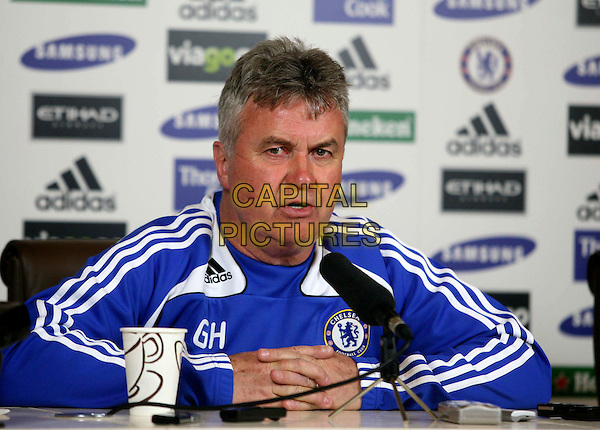 GUUS HIDDINK (Chelsea manager).Media conference to preview Chelsea vs Everton at Chelsea's Training Ground in Cobham, England..April 21st, 2009.half length blue white striped stripes top jacket microphone .CAP/DS.©Dudley Smith/Capital Pictures