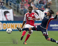 Portland Timbers midfielder/defender Lovel Palmer (30) passes the ball as New England Revolution midfielder Lee Nguyen (24) defends. In a Major League Soccer (MLS) match, the New England Revolution defeated Portland Timbers, 1-0, at Gillette Stadium on March 24, 2012