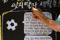 Los Angeles, CA -  Sunday, June 22, 2014: A sign in hangul.  Thousands of Koreans watched the South Korea vs. Algeria first round match on the  front lawn of Wilshire Park Place.