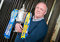 Former Falkirk player and current youth team coach Steve Fulton gets his hands on the Scottish Cup ahead of their game against Forfar.