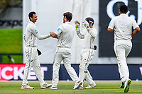 Colin De Grandhomme of the Black Caps and Jeet Raval of the Black Caps celebrates the wicket of Ben Stokes of England during Day 4 of the Second International Cricket Test match, New Zealand V England, Hagley Oval, Christchurch, New Zealand, 2nd April 2018.Copyright photo: John Davidson / www.photosport.nz