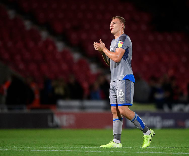 Lincoln City's Harry Anderson applauds the fans at the final whistle<br /> <br /> Photographer Chris Vaughan/CameraSport<br /> <br /> EFL Leasing.com Trophy - Northern Section - Group H - Doncaster Rovers v Lincoln City - Tuesday 3rd September 2019 - Keepmoat Stadium - Doncaster<br />  <br /> World Copyright © 2018 CameraSport. All rights reserved. 43 Linden Ave. Countesthorpe. Leicester. England. LE8 5PG - Tel: +44 (0) 116 277 4147 - admin@camerasport.com - www.camerasport.com