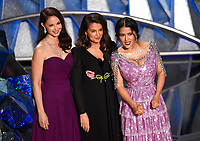 Ashley Judd, from left, Annabella Sciorra and Salma Hayek speak at the Oscars on Sunday, March 4, 2018, at the Dolby Theatre in Los Angeles. (Photo by Chris Pizzello/Invision/AP)