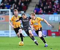 Lincoln City's Harry Anderson under pressure from Cambridge United's Liam O'Neil, left, and Brad Halliday<br /> <br /> Photographer Andrew Vaughan/CameraSport<br /> <br /> The EFL Sky Bet League Two - Cambridge United v Lincoln City - Saturday 29th December 2018  - Abbey Stadium - Cambridge<br /> <br /> World Copyright © 2018 CameraSport. All rights reserved. 43 Linden Ave. Countesthorpe. Leicester. England. LE8 5PG - Tel: +44 (0) 116 277 4147 - admin@camerasport.com - www.camerasport.com