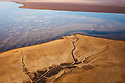 Kenya, Rift Valley, small creek flowing into Lake Logipi in northern Kenya: this lake is an important breeding ground for lesser flamingos