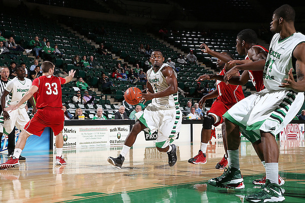 Denton, TX - NOVEMBER 14: Maurice Aniefiok #1 of the North Texas Mean Green drives in against the Nicholls State University Colonels at Super Pit - North Texas Coliseum  in Denton on November 14, 2013 in Denton, Texas. (Photo by Rick Yeatts)