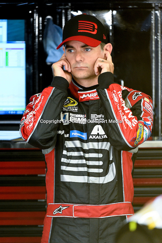 September 19, 2014 - Loudon, New Hampshire, U.S. -  Sprint Cup Series driver Jeff Gordon (24) protects his ears from engine noise during a practice session of the NASCAR Sprint Cup Series Sylvania 300 held at the New Hampshire Motor Speedway in Loudon, New Hampshire.   Eric Canha/CSM