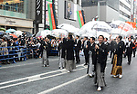 March 27, 2013, Tokyo, Japan - Leading Kabuki actors walk in the rain during a parade through the main street of Tokyo's Ginza shopping district on Wednesday, March 27, 2013, in celebration of the grand opening of new Kabuki theater. After three years of renovation, the majestic theater for Japan's centuries-old performing arts of Kabuki will open its doors to the public with a three-month series of most sought-after plays.   (Photo by Kaku Kurita/AFLO)