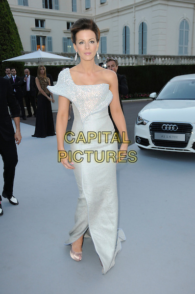 KATE BECKINSALE.arrivals at amfAR's Cinema Against AIDS 2010 benefit gala at the Hotel du Cap, Antibes, Cannes, France during the Cannes Film Festival.20th May 2010.amfAR full length long maxi dress one shoulder white silver diamante shiny sparkly sculpted hair up beige silk satin peep toe platform shoes .CAP/CAS.©Bob Cass/Capital Pictures.