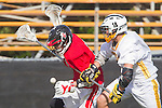 Palos Verdes, CA 03/30/10 - unidentified Palos Verdes player and Jin Matsumoto (Peninsula #14) in action during the Palos Verdes-Peninsula Varsity CIF Boys lacrosse game at Peninsula HS.