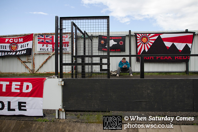 Hednesford Town 2 FC United 1, 11/05/2013. Key's Park, Northern Premier League. A solitary away fan reading his programme surrounded by flags and banners inside Key's Park prior to the Hednesford Town versus FC United of Manchester Northern premier League Premier division play-off final. The match would decide which club were promoted to the Blue Square Conference North. Hednesford won the game by 2 goals to 1 in front of a stadium record attendance of 4412 spectators. Photo by Colin McPherson.