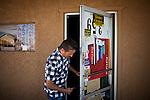 Joe Riofrio locks up his closed store, the Westside Grocery in Mendota, Calif., September 10, 2012.